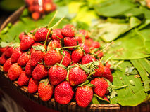 Strawberry on banan leaf. And basket Royalty Free Stock Image