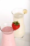 Strawberry and banana milk shake closeup stock images