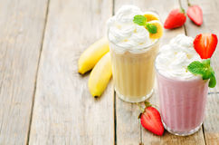 Strawberry and banana milkshake with whipped cream Royalty Free Stock Photography