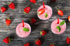 Strawberry Banana Smoothies Cups with straws and mint Stock Photos