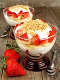 Strawberry banana yogurt parfaits on wood Royalty Free Stock Image