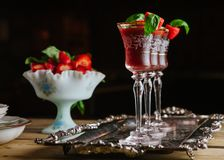 Strawberry and basil cocktails on silver tray stock photo