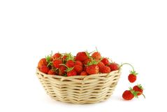 Strawberry in the basket. Handful of strawberry in the basket on the white background royalty free stock photo