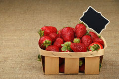 Strawberry in basket with price sign on canvas Stock Images