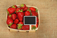 Strawberry in basket with price sign on canvas royalty free stock images