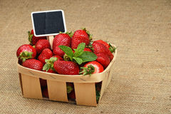 Strawberry in basket with price sign on canvas Royalty Free Stock Image