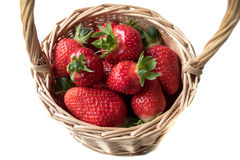 Strawberry in a basket on a white background. Red, juicy, ripe strawberry in a basket on a white background Royalty Free Stock Image