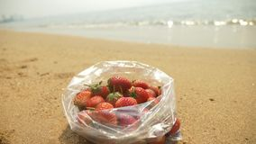 Strawberry on the beach, sea. slow motion stock footage