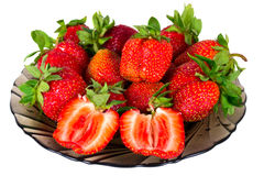 Strawberry berries. On plate isolated on white Royalty Free Stock Images