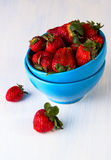 Strawberry berries in a blue cup Stock Photos