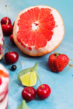 Strawberry, berries, grapefruit and lime for dessert Stock Image