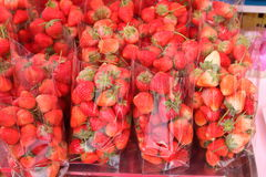 Strawberry berries pack a lot into a clear plastic bag. Royalty Free Stock Image
