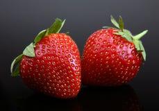 Strawberry berry on black Royalty Free Stock Photo
