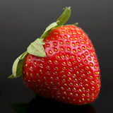 Strawberry berry on black Stock Photos