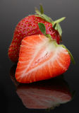 Strawberry berry on black Stock Images