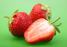 Strawberry berry on green Stock Photo