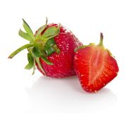 Strawberry berry with leaves and a slice Stock Photo