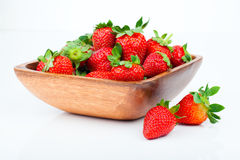Strawberry berry in wooden bowl Stock Photo