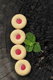 Strawberry biscuits is delicious on wood background. Royalty Free Stock Image