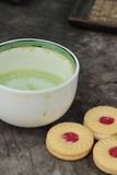 Strawberry biscuits with green tea is delicious. Stock Photography