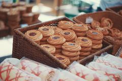 Strawberry biscuits on market table color graded. Strawberry biscuits on market table at spring, color graded, cinematic style, outdoors royalty free stock image