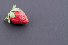 Strawberry. A strawberry on a black background Royalty Free Stock Photos