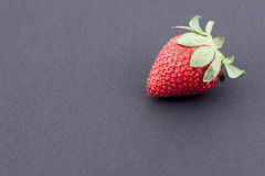 Strawberry. A strawberry on a black background Stock Image
