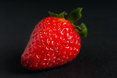Strawberry on a black background Royalty Free Stock Photos