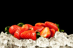 Strawberry on black background.  strawberries with ice cubes on Royalty Free Stock Photo