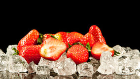 Strawberry on black background. Stock Photos