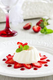 Strawberry blancmange garnished. With fresh strawbe royalty free stock photography