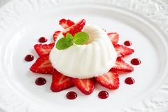 Strawberry blancmange garnished Royalty Free Stock Photo