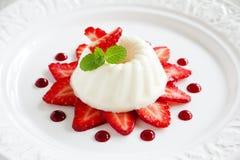 Strawberry blancmange garnished. With fresh strawbe royalty free stock photo