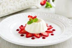 Strawberry blancmange. Garnished with fresh strawbe royalty free stock images