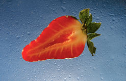 Strawberry on blue Royalty Free Stock Image