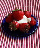 Strawberry in the blue dish. Close up Stock Photo