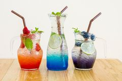 Strawberry , blue Hawaii , and blueberry italian soda. On wooden table Royalty Free Stock Photography