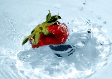 Strawberry in blue water Royalty Free Stock Image
