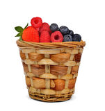 Strawberry with blueberries and raspberries in wooden basket Stock Image