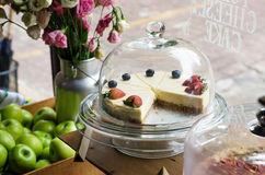 Strawberry and Blueberry cheesecake on cake stand Stock Photo