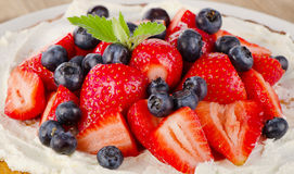 Strawberry and blueberry  cream cake Stock Photography