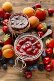 Strawberry and blueberry jams in glass jars Royalty Free Stock Photos