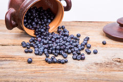 Strawberry, blueberry, or raspberry scattered from pot over wood. En background. Health and diet concept. Copy space Royalty Free Stock Image