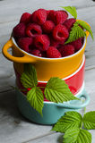 Strawberry, blueberry, or raspberry. In a yellow single pot over wooden background. Health and diet concept. Copy space Royalty Free Stock Photo