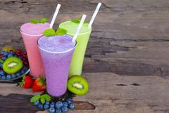 Strawberry and blueberry smoothies smoothies juice beverage healthy the taste yummy In glass drink episode morning on wooden backg. Round royalty free stock images
