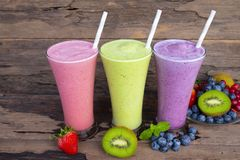 Strawberry and blueberry smoothies smoothies juice beverage healthy the taste yummy In glass drink episode morning on wooden backg. Round stock images