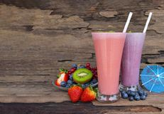 Strawberry and blueberry smoothies juice beverage healthy the taste yummy in glass . Strawberry and blueberry smoothies juice beverage healthy the taste yummy stock image
