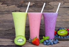 Strawberry and blueberry smoothies smoothies juice beverage healthy the taste yummy In glass drink episode morning on wooden backg. Round stock photography