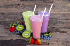 Strawberry and blueberry smoothies smoothies juice beverage healthy the taste yummy In glass drink episode morning on wooden backg. Round royalty free stock image