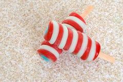 Strawberry blueberry vanilla swirl popsicle Stock Photo
